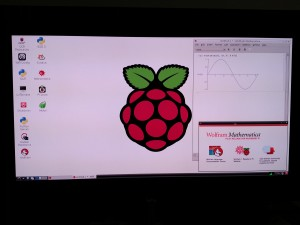 Raspberry Pi booted and running in GUI mode showing a Mathematica plot of Sin[x]